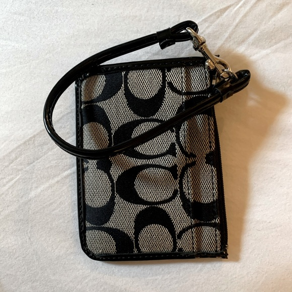 coach card wallet with wrist strap